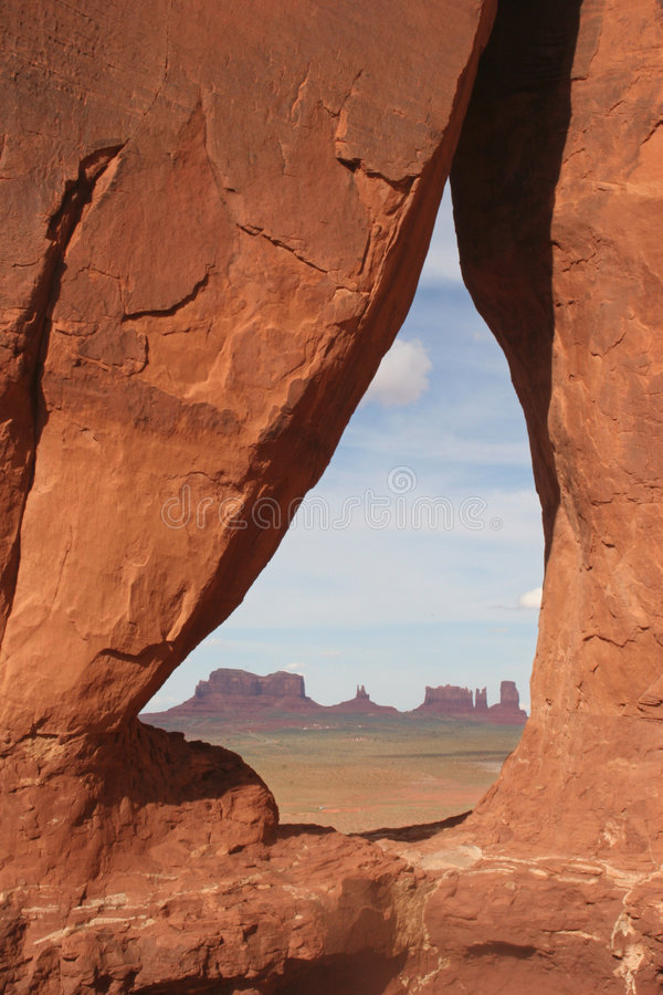 Teardrop arch to Monument valley stock image