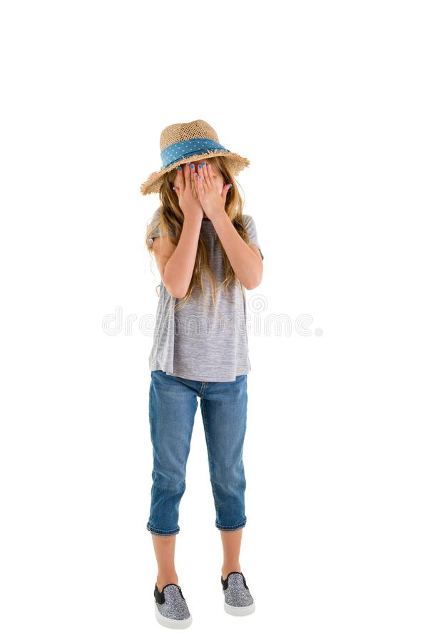 Tearful little girl covering her eyes royalty free stock images