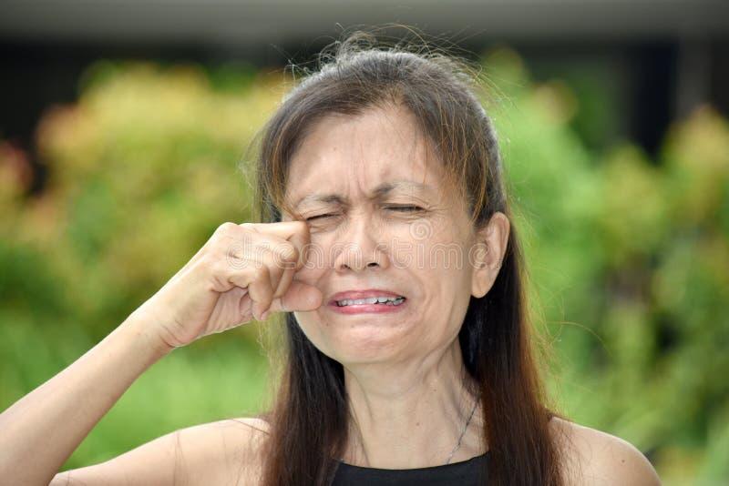 Tearful Old Asian Female Senior. A pretty adult female woman stock photography
