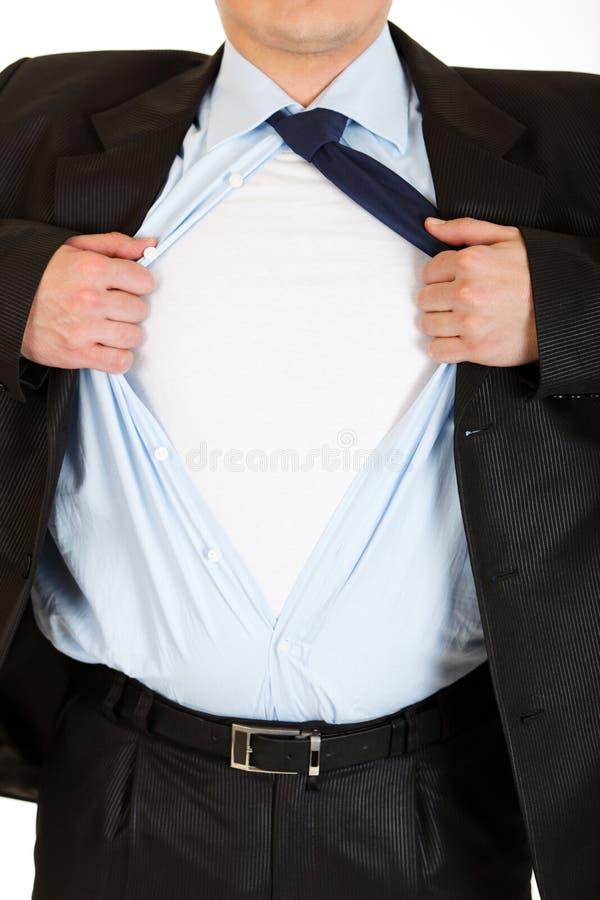 Tearing de superman van de zakenman zijn overhemd. Close-up. royalty-vrije stock afbeeldingen