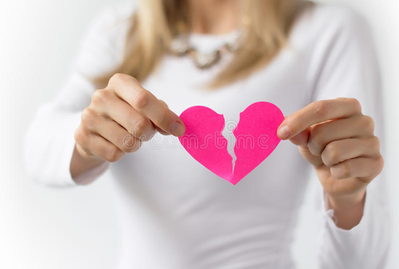Tearing up pink paper heart royalty free stock image