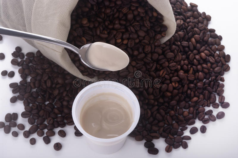 Teaspoon of yogurt coffee. On a white background stock images