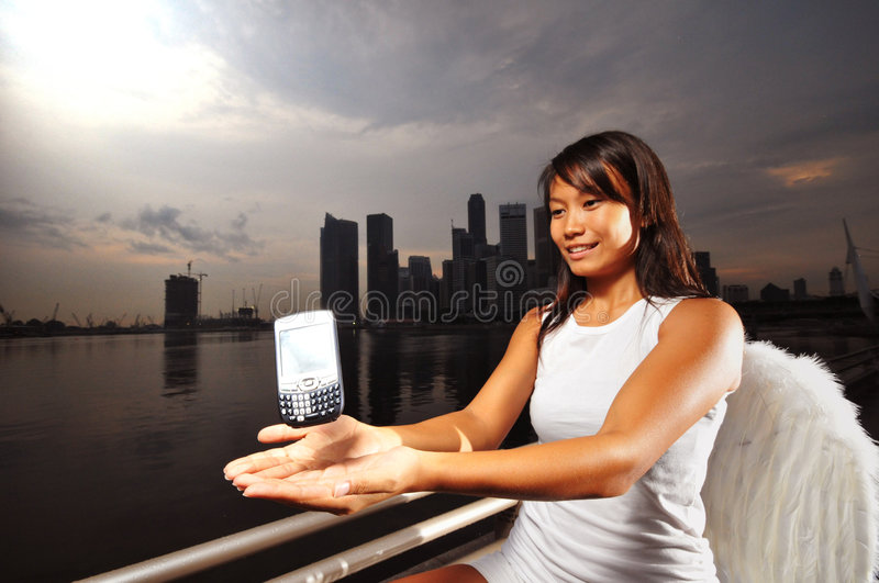 Tech Angel in the city - 2 royalty free stock images