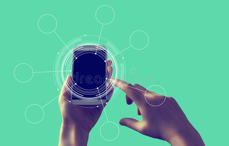 Tech circle with smartphone. Tech circle with person holding a white smartphone stock illustration