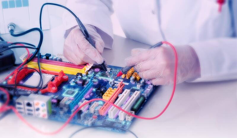 Tech or engineer tests electronic motherboard in service centre. Panoramic technology background with close-up on electronic board stock photos