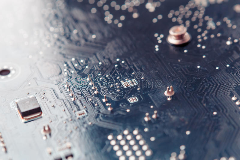 Tech science background. Circuit board. Electronic computer hardware technology. Toned image, macro photo stock photos