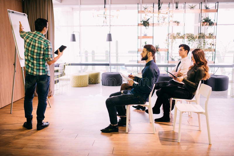 Tech start-up business team discussing product roadmap for product and investment in office stock image