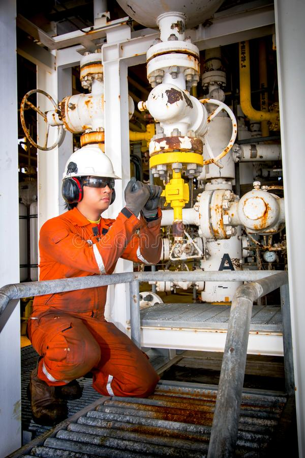 Techincian operator during close or open valve in process oil and gas platform offshore industrail royalty free stock images