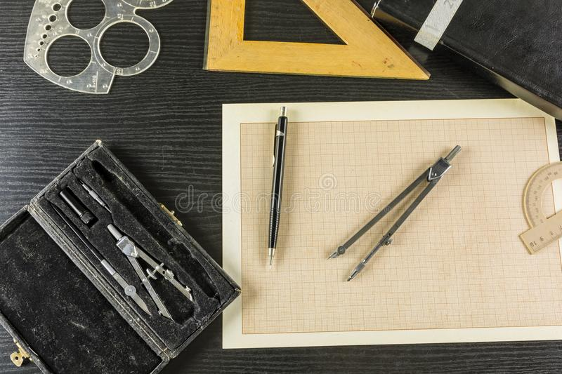 Technical drawing on graph paper - useful equipment. royalty free stock images