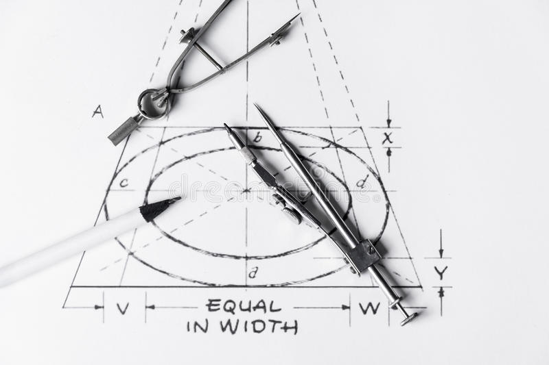 Technical drawing tools. Metal technical drawing tools - compasses - and white pencil stock images