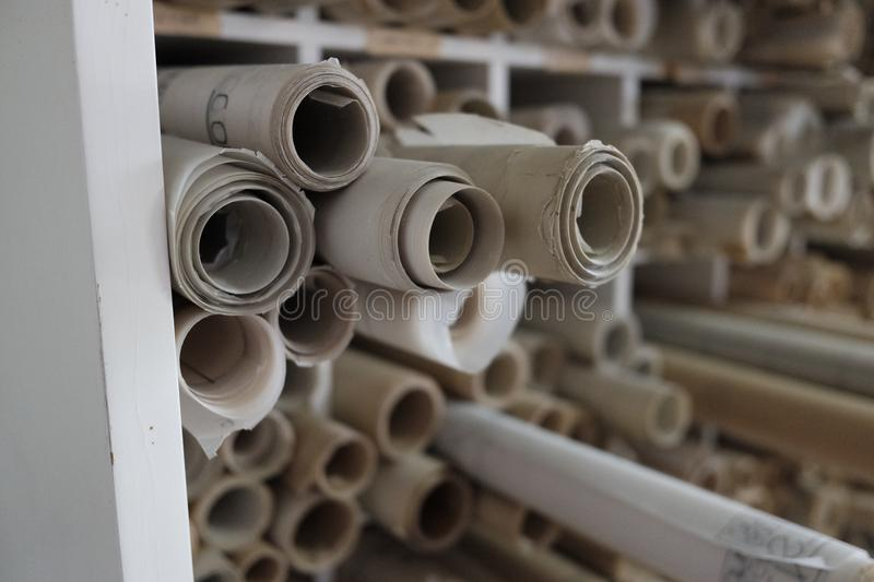 Technical drawings on rolled glossy paper. Day stock image