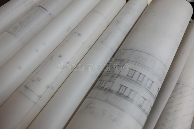Technical drawings on rolled glossy paper. Day royalty free stock photo