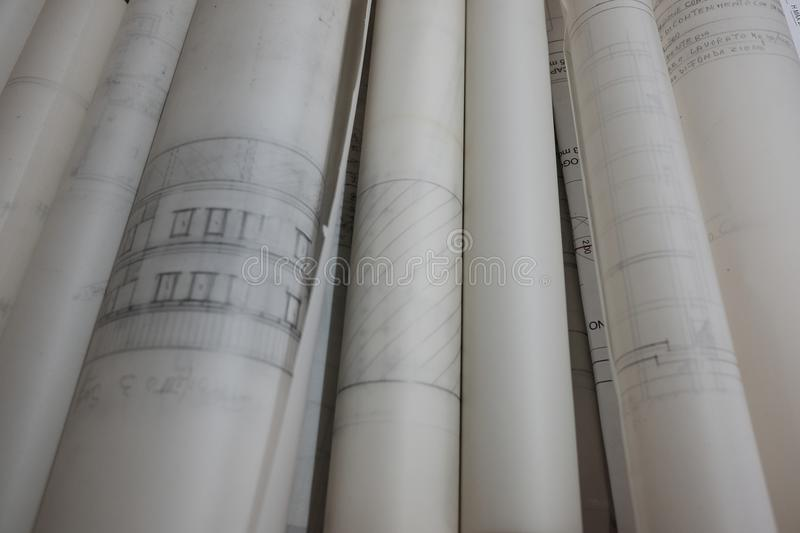 Technical drawings on rolled glossy paper. Day royalty free stock image