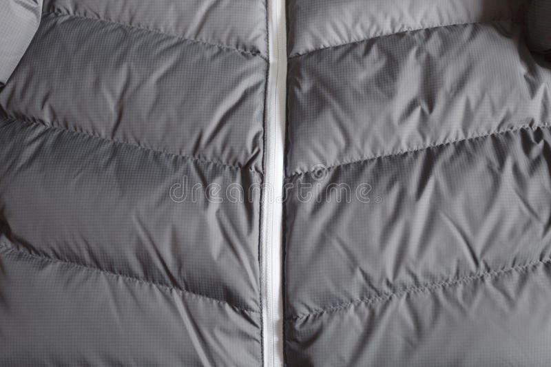 Technical duvet for mountain sport activities royalty free stock images