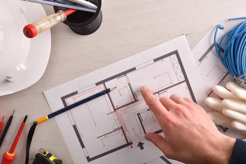 Technical electrician preparing an electrical project of housing in office stock photography