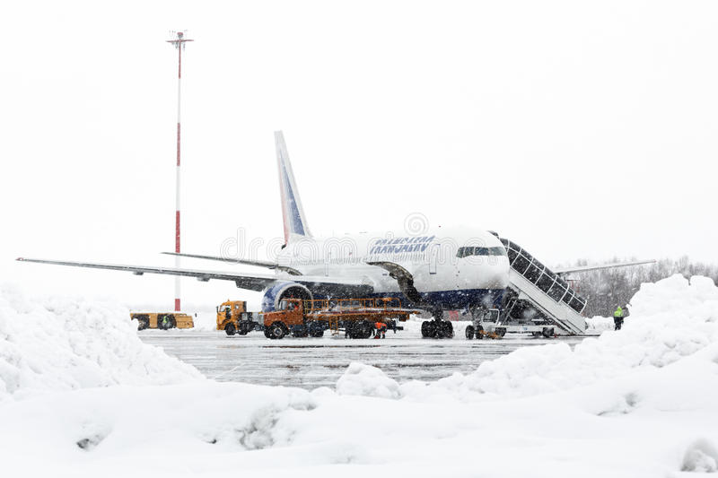 Technical and service support airfield maintenance Boeing-767 at airport Petropavlovsk-Kamchatsky. PETROPAVLOVSK, KAMCHATKA, RUSSIA - MARCH 19, 2015: Technical stock photo