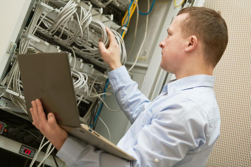 Support network service engineer with server computer equipment. Technical support. network service engineer or administrator work with server computer equipment royalty free stock images
