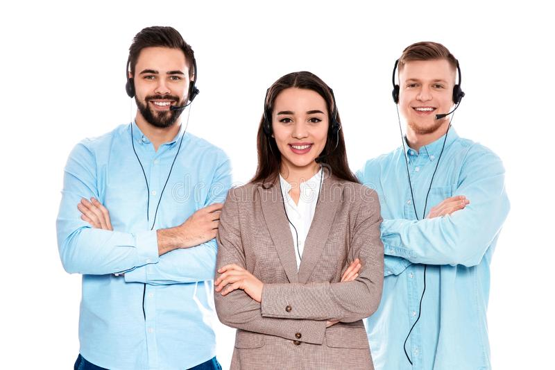 Technical support operators with headsets on white. Technical support operators with headsets isolated on white royalty free stock photography