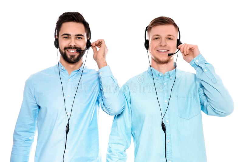 Technical support operators with headsets on white. Technical support operators with headsets isolated on white stock photo