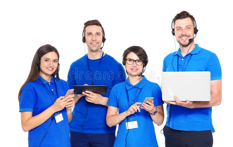Technical support operators with headsets. On white background stock photos