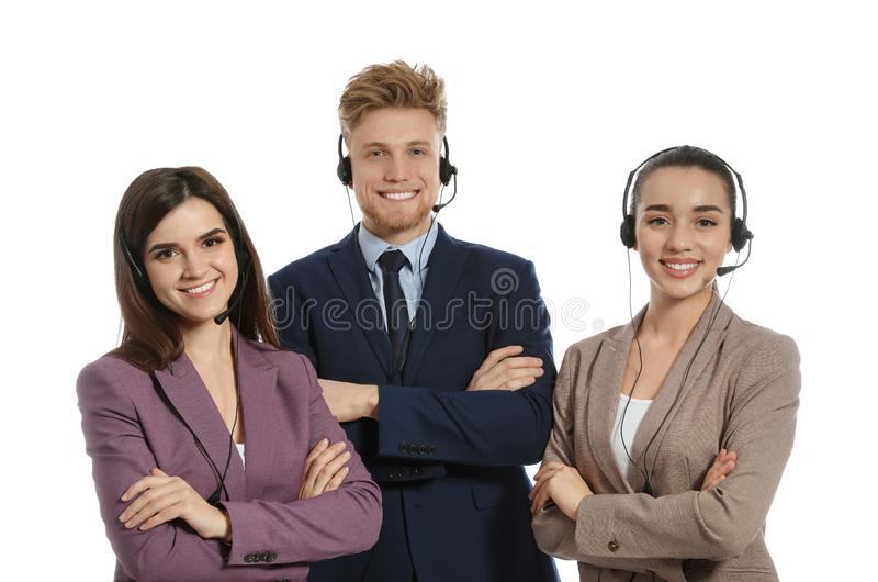 Technical support operators with headsets. On white background stock images