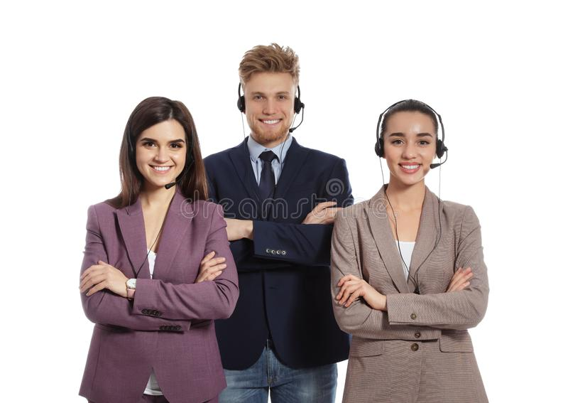 Technical support operators with headsets. On white background royalty free stock image