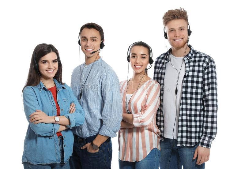 Technical support operators with headsets. On white background stock photo