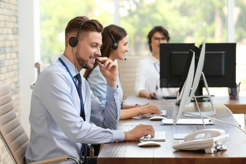 Technical support operators with headsets. At workplace royalty free stock images