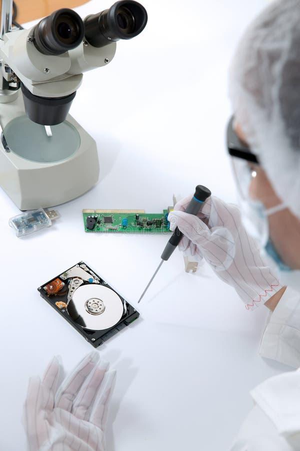 Technical surgeon working on hard drive - data recovery. Studio shoot stock photo