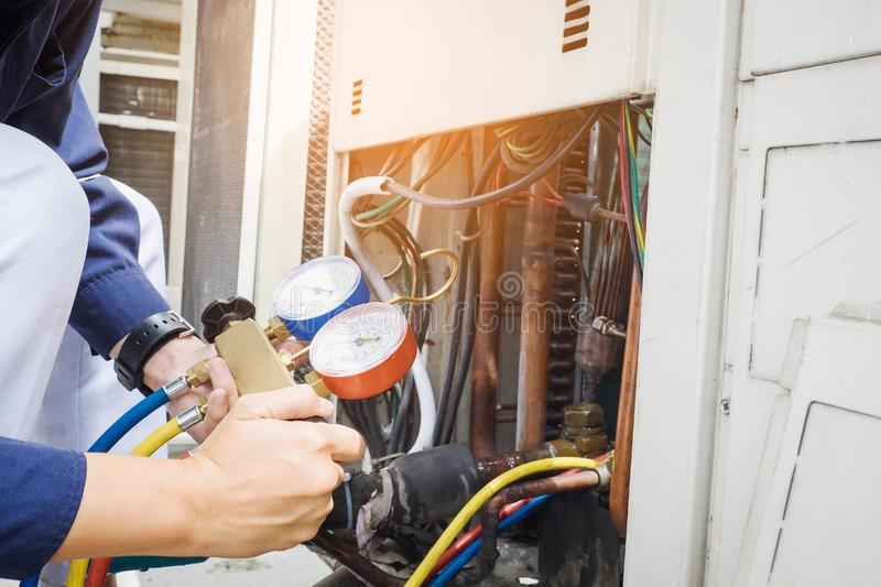Technician checking air conditioner stock images