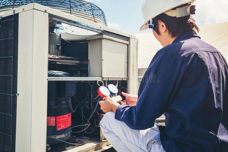 Technician is checking air conditioner royalty free stock images