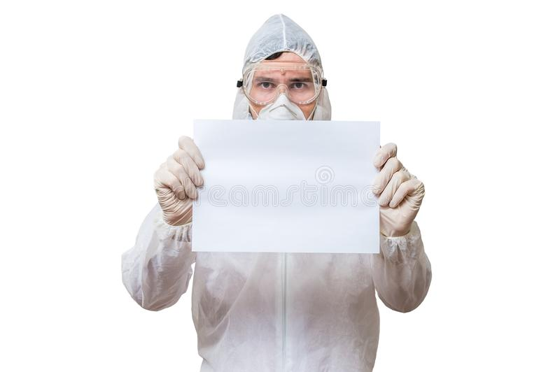 Technician in coveralls is holds blank paper for custom text. Isolated on white background stock photography