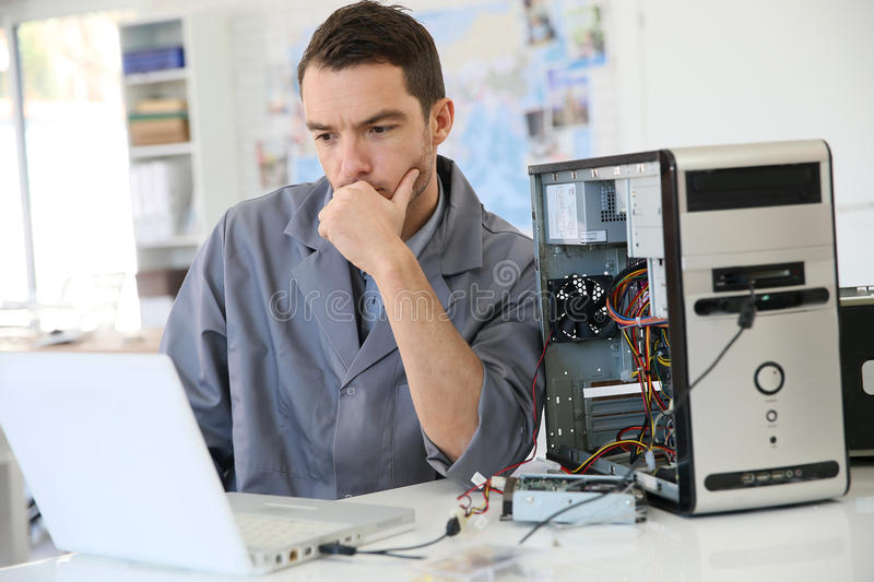 Technician fixing the computer stock photography