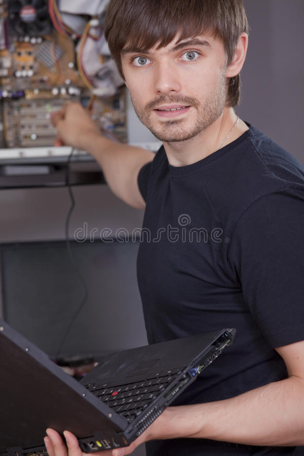 Technician fixing problem on computer stock images