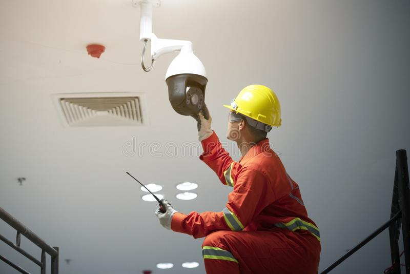 Technician fixing video surveillance CCTV stock image