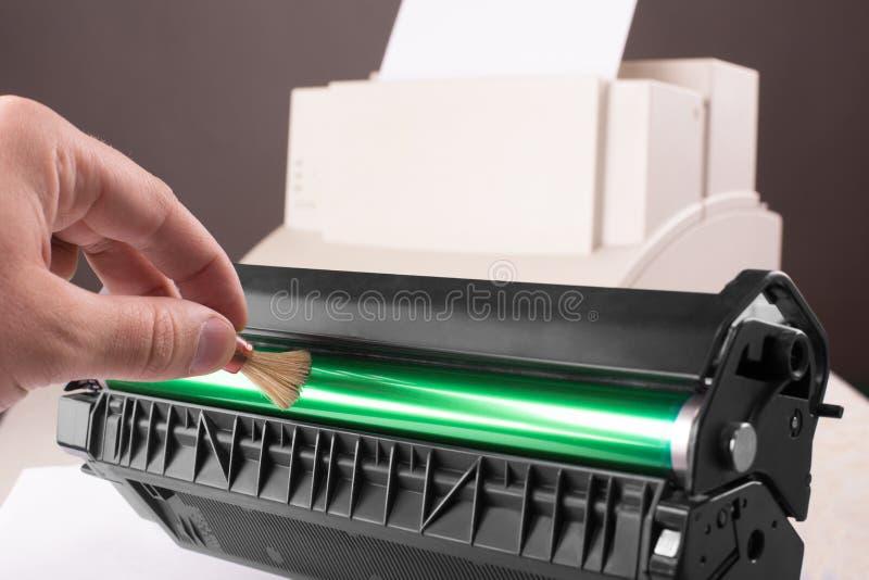 Cleaning printer toner cartridge stock images