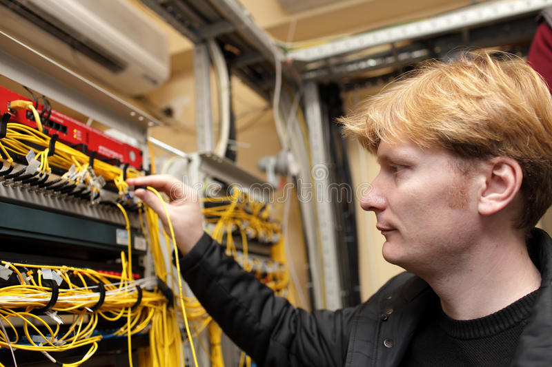 Download Technician Holding Optical Connector Stock Photo - Image: 22956742