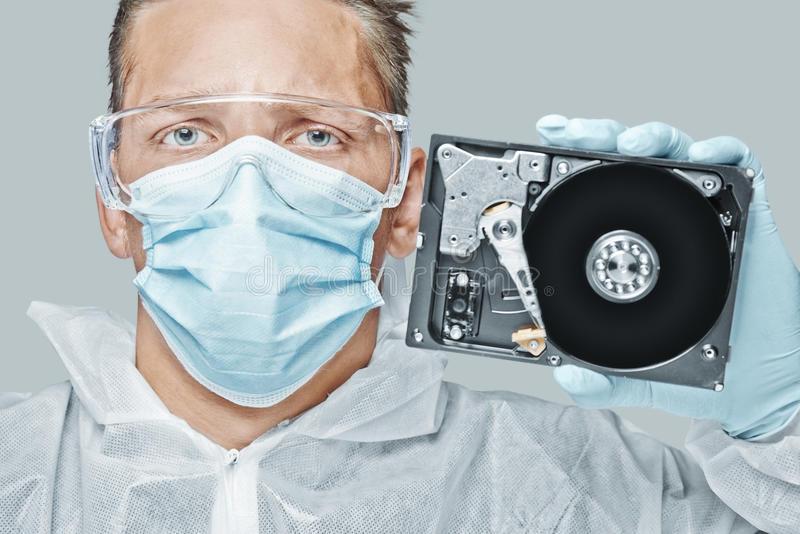 Technician holds the hard disk royalty free stock image