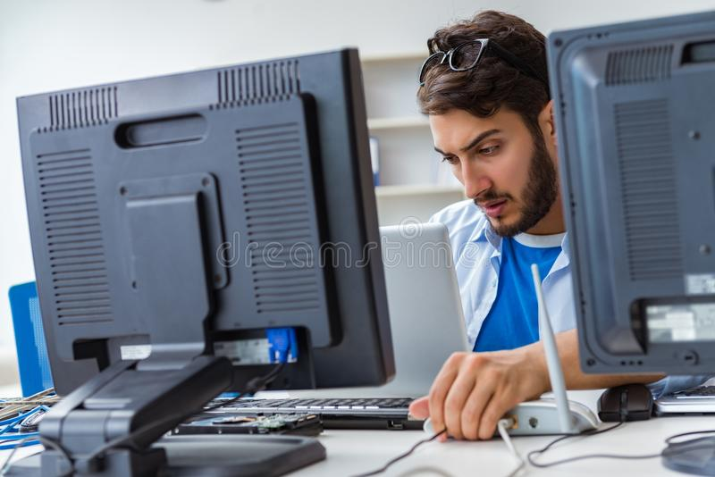 The it technician looking at it equipment royalty free stock images