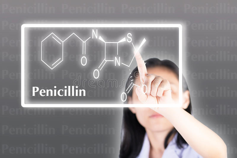 Technician pressing penicillin chemical structure on computer wi royalty free stock images