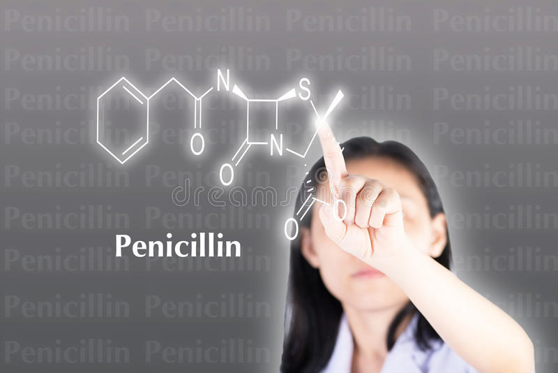 Technician pressing penicillin structure on computer royalty free stock images