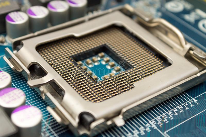 CPU on the socket of the computer motherboard. stock photography