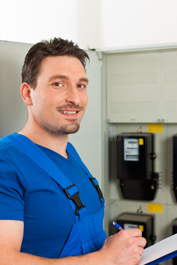 Download Technician Reading The Electricity Meter Stock Photos - Image: 18050093