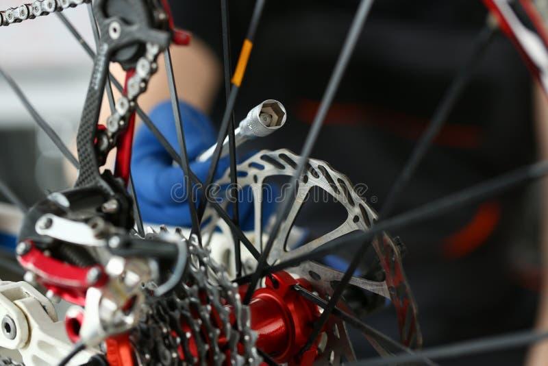 Technician Repair Speed Bike at Workshop Close-up royalty free stock image