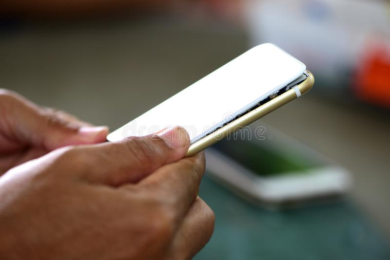 Repairing mobile phones and tablets by skilled technicians. stock images