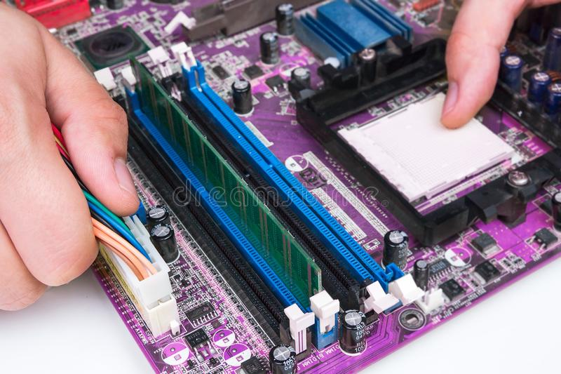 Technician repairing computer hardware. Computer service concept royalty free stock image