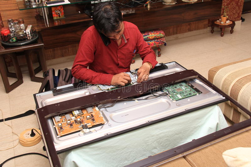 Technician Repairing electronic Circuit stock image