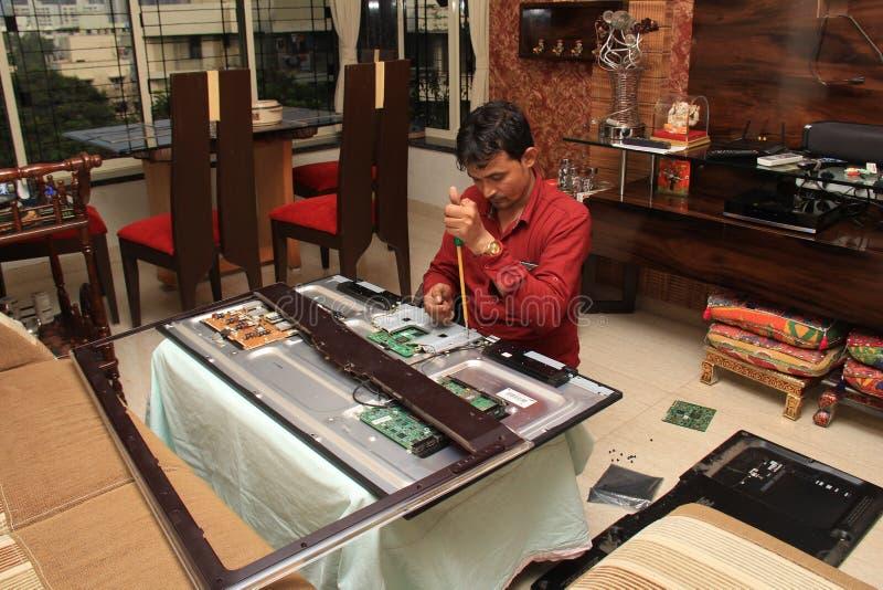 Technician Repairing LED home equipment stock photos