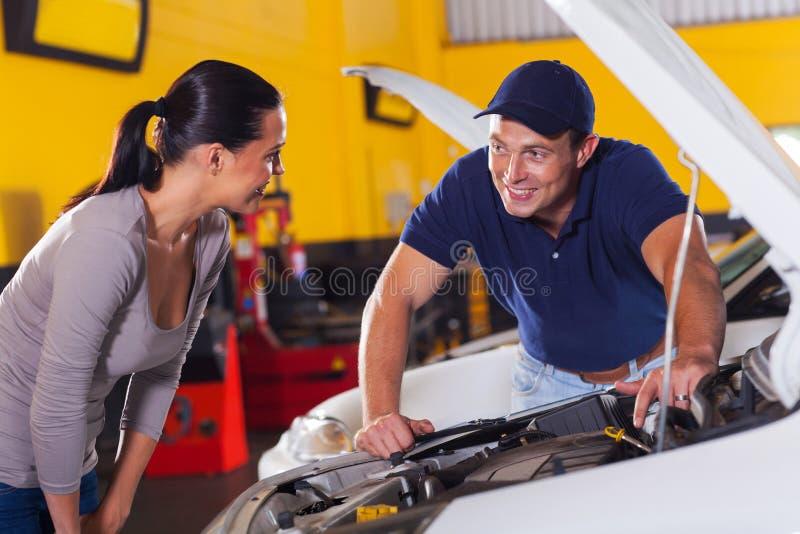 Technician talking customer stock images