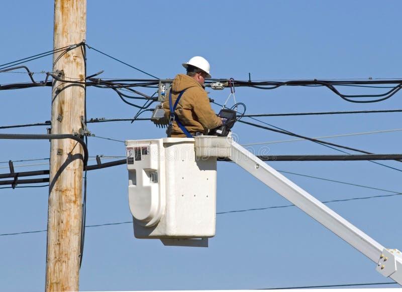 Download Technician working 2 stock image. Image of bucket, telephone - 1558737